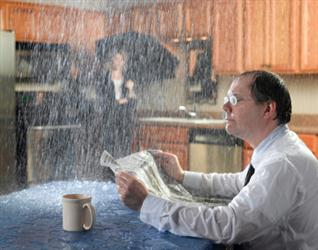 People in need of roof repair in Euless TX. Leaky roof causing it to rain on people in their kitchen. Humorous.